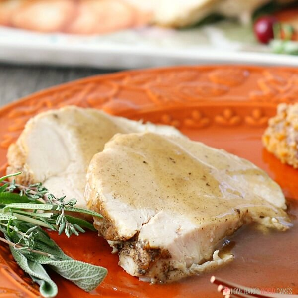 Close up view of one serving of pressure cooker turkey breast on a plate ready to be enjoyed with gravy.