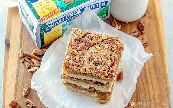 Skip the pie and make these Pecan Pie Bars! Shortbread topped with a gooey filling and crunchy pecans in an easy-to-eat with your hands' bar!