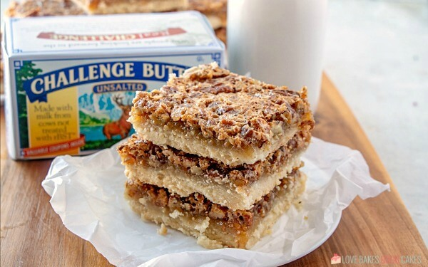 horizontal shot of Pecan Pie Bars with Challenge Butter and a glass of milk