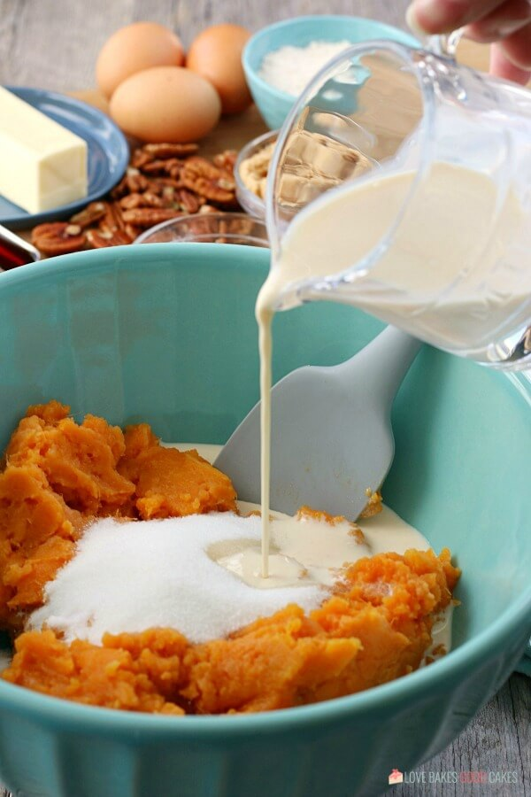 More ingredients being added to the mixture for the sweet potato casserole with pecans.