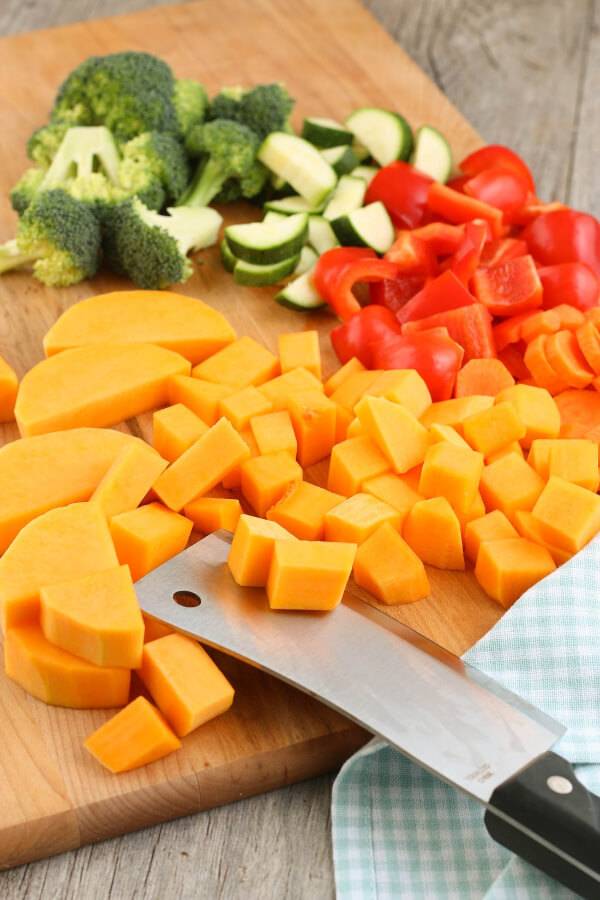 The first step in making chicken sheet pan meals is to cut up our vegetables!