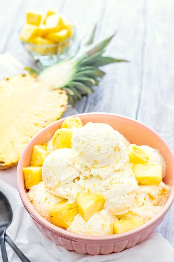 No-Churn Pineapple Ice Cream with split pineapple in background
