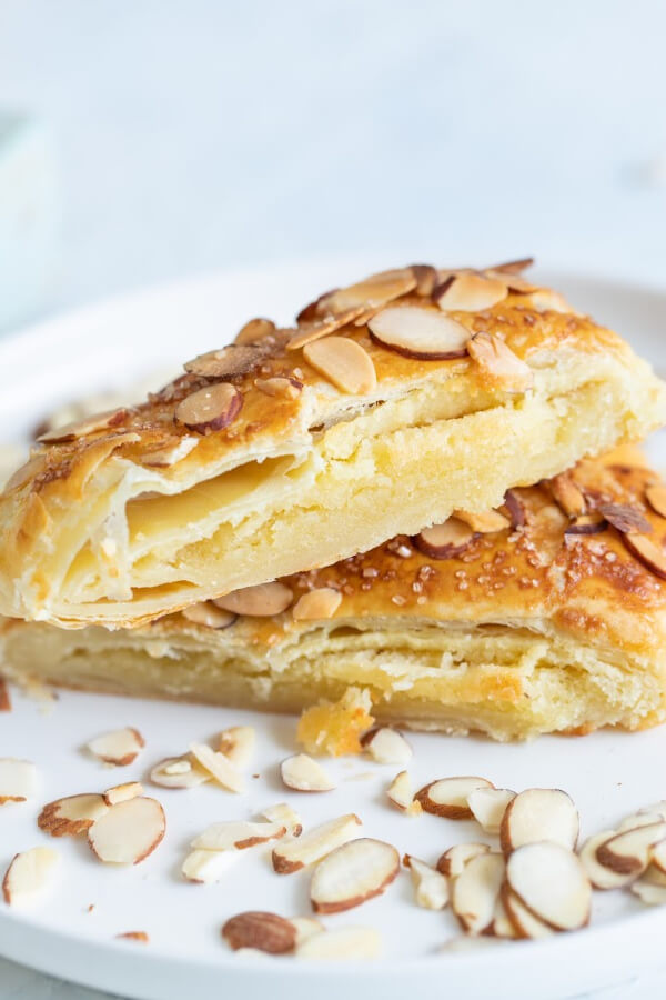 almond bear claw slices stacked on white plate