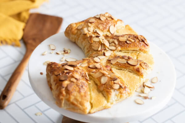 almond bear claw on cake stand