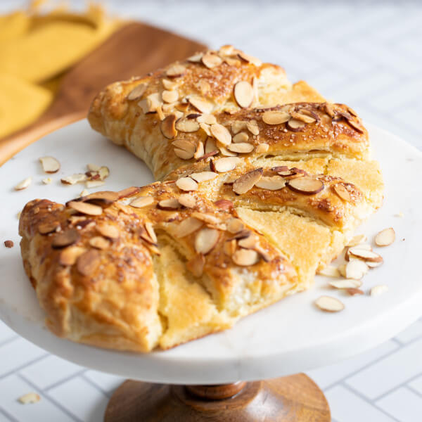 almond bear claw recipe on cake stand