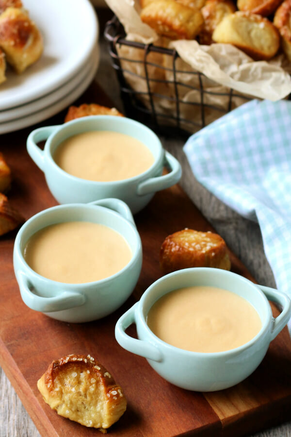 three small bowls of beer cheese dip