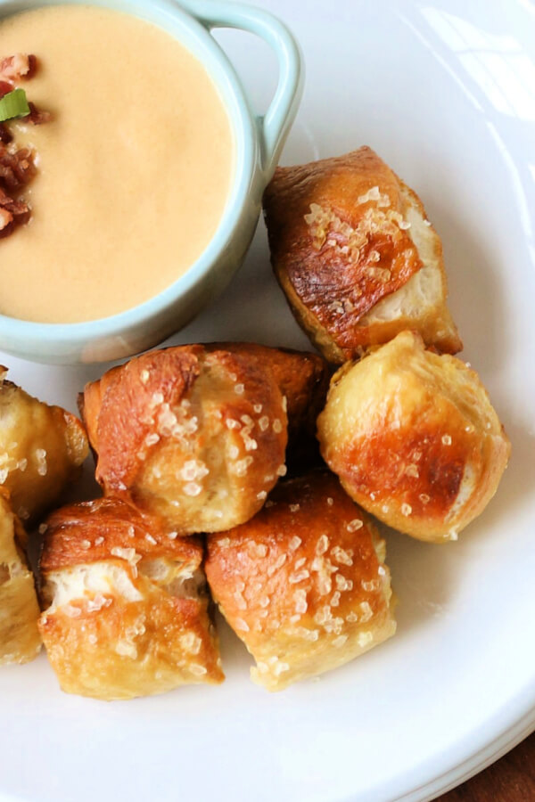 pretzel bites on plate with cheese dip